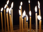 Prayer candles at the Church of the Holy Sepulchre in Jerusalem